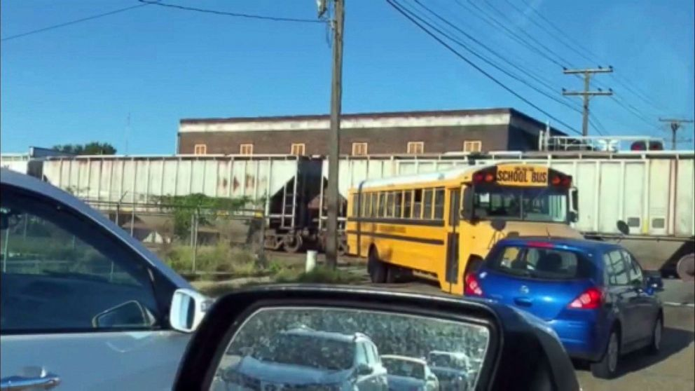 PHOTO: An image made from video appears to show a school bus for the East Baton Rouge Parish schools making an illegal turn near a stopped train.