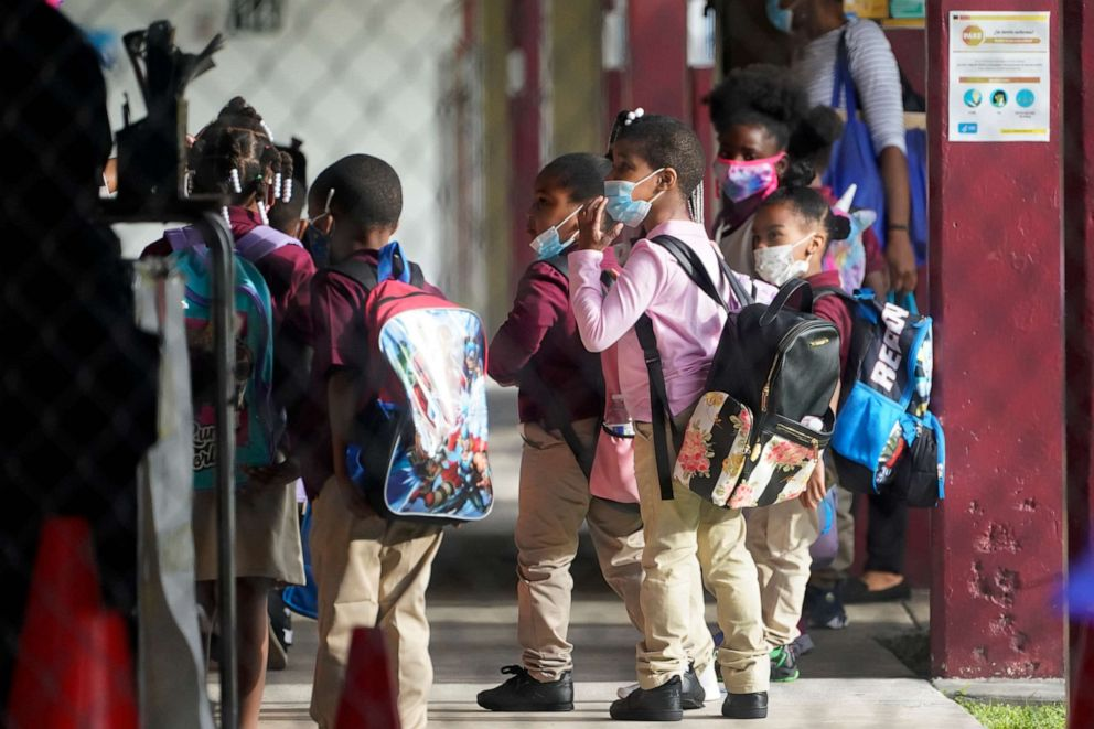 PHOTO: Children wait to enter classrooms, Oct. 5, 2020, at the Carrie P. Meek/Westview K-8 Center in Miami.