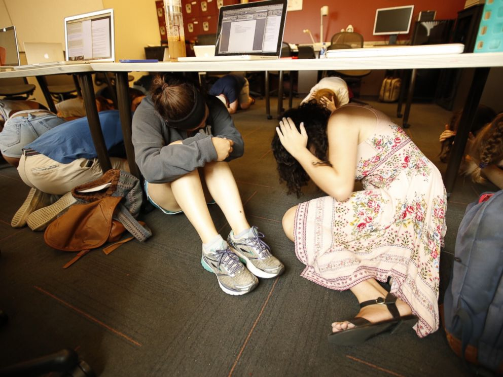 PHOTO: Students take cover under their desks during a drill in this undated stock image.