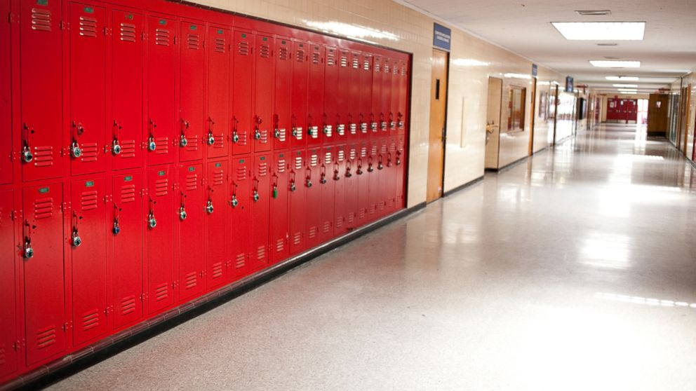 A high school hallway with lockers  is pictured in this undated stock photo.