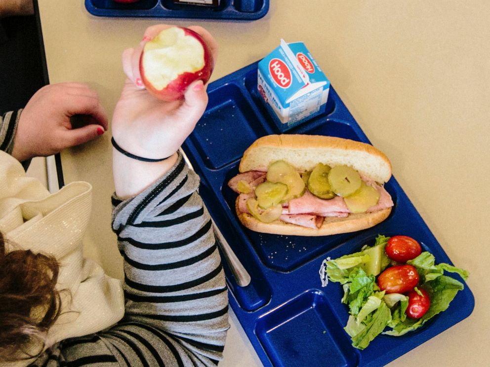 PHOTO: A student bites into an macintosh apple at Westbrook Middle School in Westrbook, M.E., on April 9, 2015.