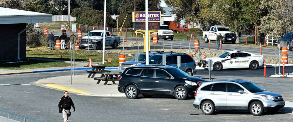 PHOTO: The Lewis and Clark County bomb squad works the scene at Rossiter Elementary school Oct. 15, 2019, after an improvised explosive device detonated on the school playground, in Helena, Mont.