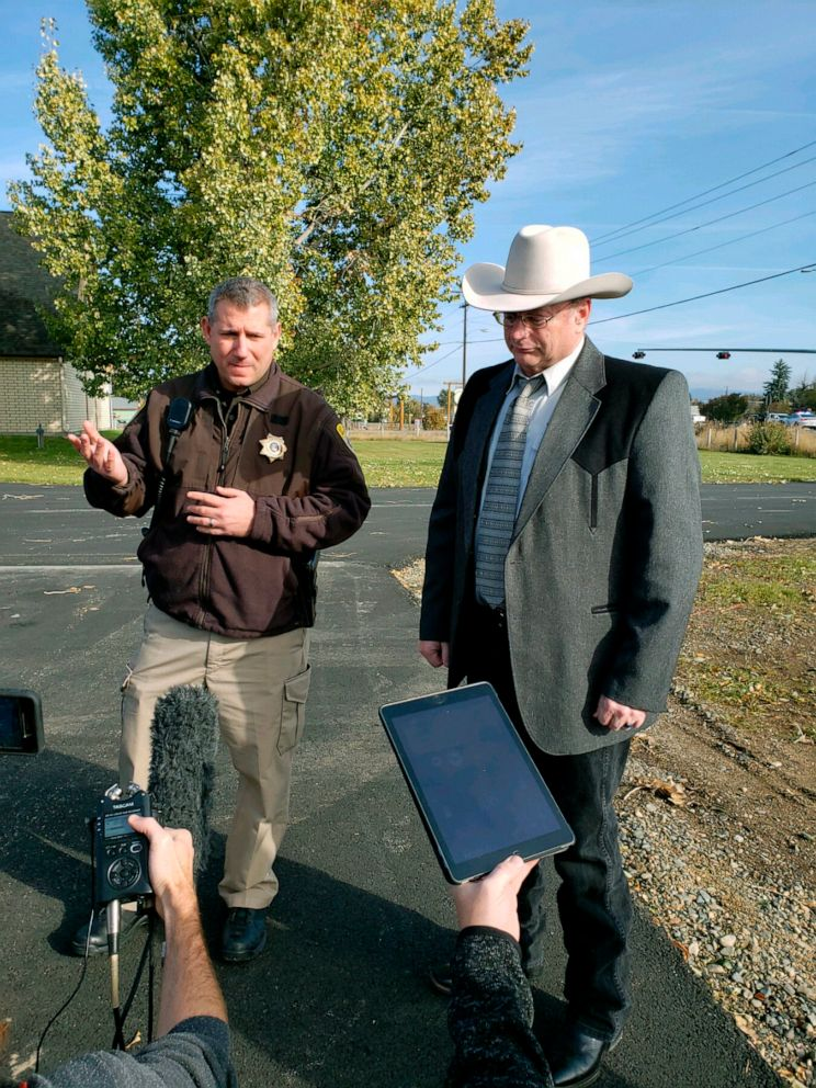 PHOTO: Lewis and Clark County Undersheriff Jason Grimmis, left, and Sheriff Leo Dutton, right, update reporters on a homemade bomb that detonated in an elementary school playground on Oct. 15, 2019, in Helena, Mont.