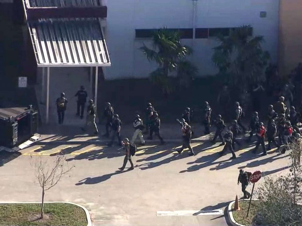 PHOTO: First responders enter Marjory Stoneman Douglas High School after a shooting in Parkland, Fla., Feb. 14, 2018.