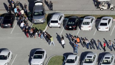 'PHOTO: Students are evacuated by police from Marjory Stoneman Douglas High School in Parkland, Fla., after a mass shooting on Feb. 14, 2018.' from the web at 'https://s.abcnews.com/images/US/school-shooting-01-ap-jc-180215_16x9t_384.jpg'