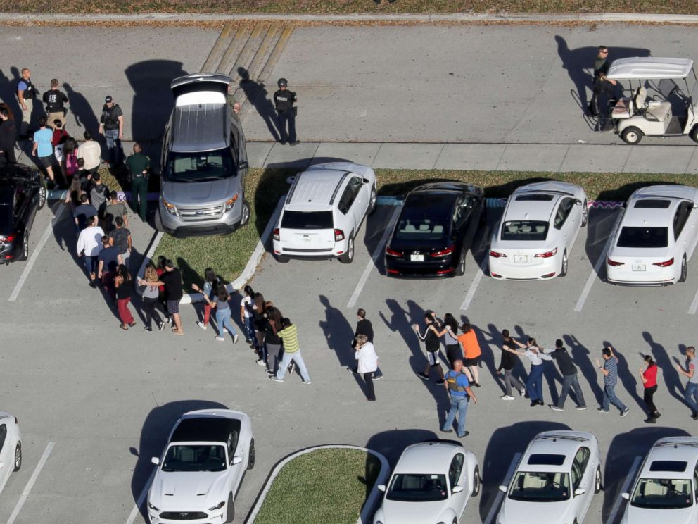 PHOTO: Students are evacuated by police from Marjory Stoneman Douglas High School in Parkland, Fla., after a mass shooting on Feb. 14, 2018.