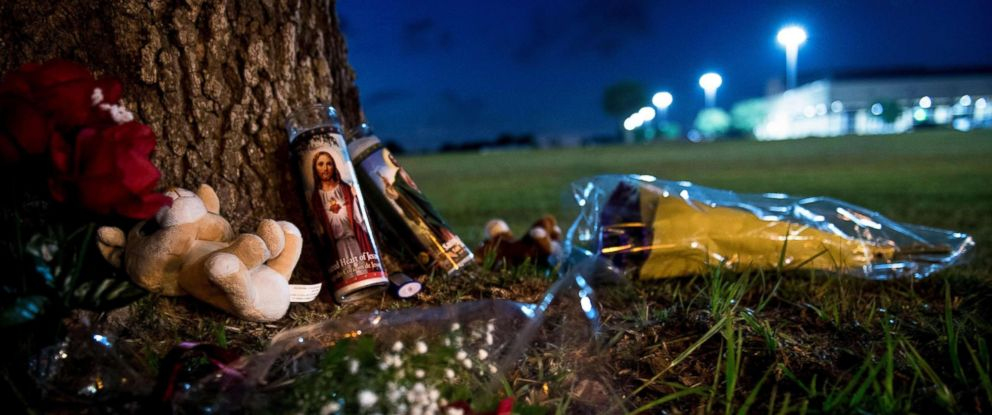 PHOTO: A makeshift memorial is seen outside Santa Fe High School a day after a mass shooting May 19, 2018 in Santa Fe, Texas.
