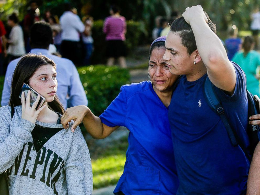 PHOTO: Students and parents embrace after a mass shooting at the Marjory Stoneman Douglas High School in Parkland, Fla., Feb. 14, 2018.