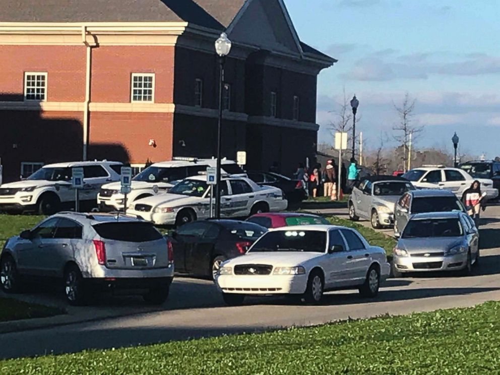 PHOTO: Authorities investigate the scene where a shooting occurred at Huffman High School, March 7, 2018, in Birmingham, Ala.