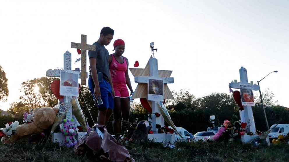 Denyse Christian visits a makeshift memorial with her son Adin Christian 16 a student at the school outside the Marjory Stoneman Douglas High School