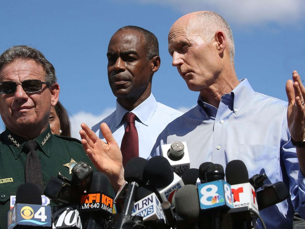PHOTO: Florida Governor Rick Scott, speaks to the media while Superintendent Robert W. Runcie and Sheriff Scott Israel look on at a press conference about a mass shooting at Marjory Stoneman Douglas High School, Feb. 15, 2018 in Parkland, Fla.