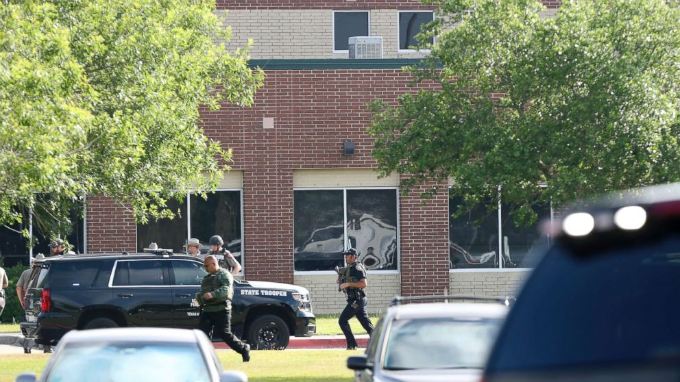 Law enforcement officers respond to Santa Fe High School after an active shooter was reported on campus, May 18, 2018, in Santa Fe, Texas.