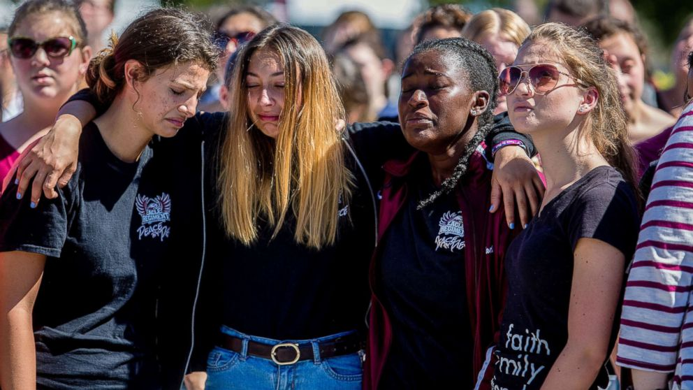 Students attend a prayer service at Parkridge Church in Coral Springs, Fla., a day after a mass shooting occurred at the nearby Marjory Stoneman Douglas High School, Feb. 15, 2018.