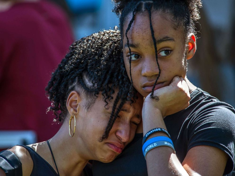 Kohen and Brianna Hall join hundreds of community members at a prayer vigil at Parkridge Church in Parkland Fla. Feb. 15 2018