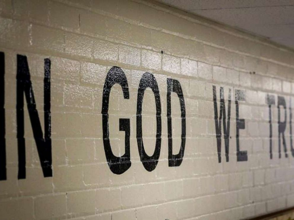 PHOTO: This July 23, 2019 photo shows In God We Trust stenciled in a wall at South Park Elementary in Rapid City, S.D.