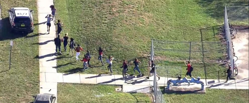 PHOTO: Students are evacuated from Marjory Stoneman Douglas High School after a shooting in Parkland, Fla., Feb. 14, 2018.