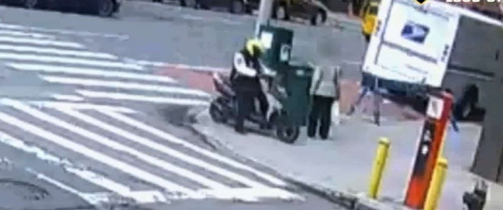 PHOTO: New York Poloce Department released video which shows a woman being dragged by a man on a motor scooter.
