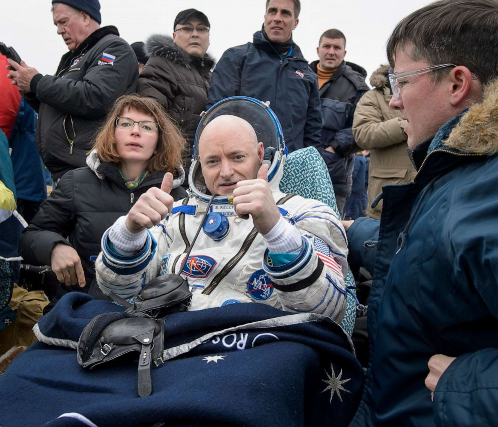 Expedition 46 Commander Scott Kelly of NASA rests in a chair outside of the Soyuz TMA-18M spacecraft just minutes after he and Russian cosmonauts Mikhail Kornienko and Sergey Volkov of Roscosmos landed in a remote area on March 2, 2016 near the town of Zhezkazgan, Kazakhstan.