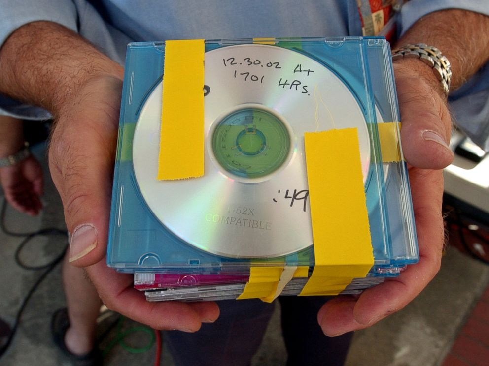 PHOTO:Media pool coordinator Peter Shaplen holds up a released audio copies outside of a Redwood City, Calif., courthouse in this Aug. 16, 2004 file photo of the taped conversations between Scott Peterson and Amber Frey.