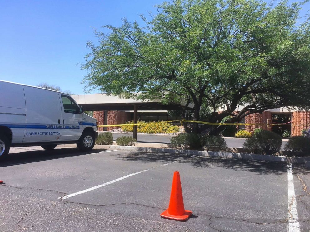 PHOTO: A Scottsdale police vehicle and crime scene tape is seen outside the Scottsdale, Ariz., building where a man was found shot to death on June 2, 2018.