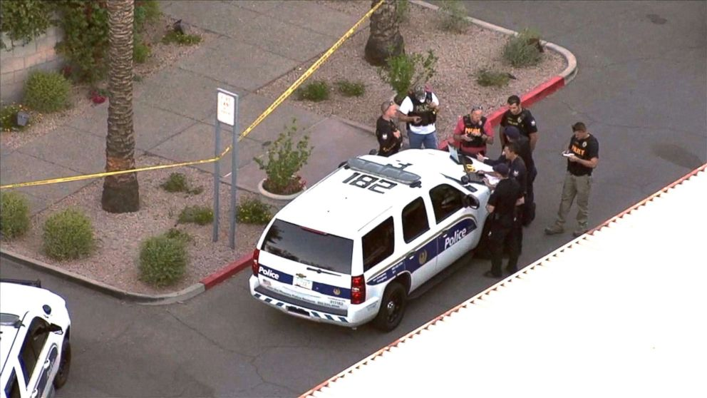 PHOTO: Law enforcement officers investigate a crime scene in Scottsdale, Ariz.