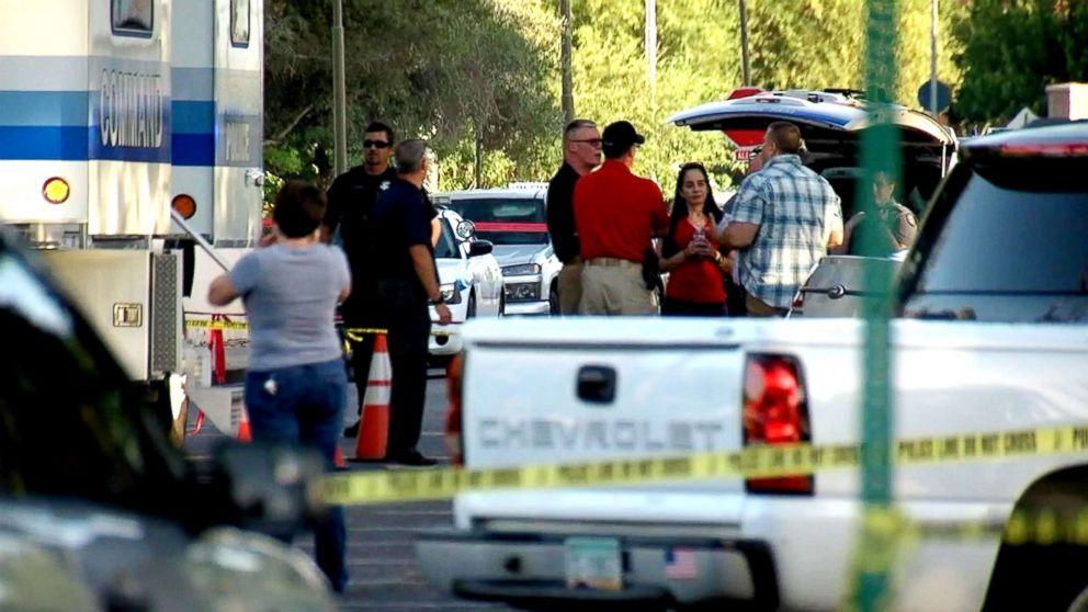 Law enforcement investigate a crime scene in Scottsdale, Ariz.