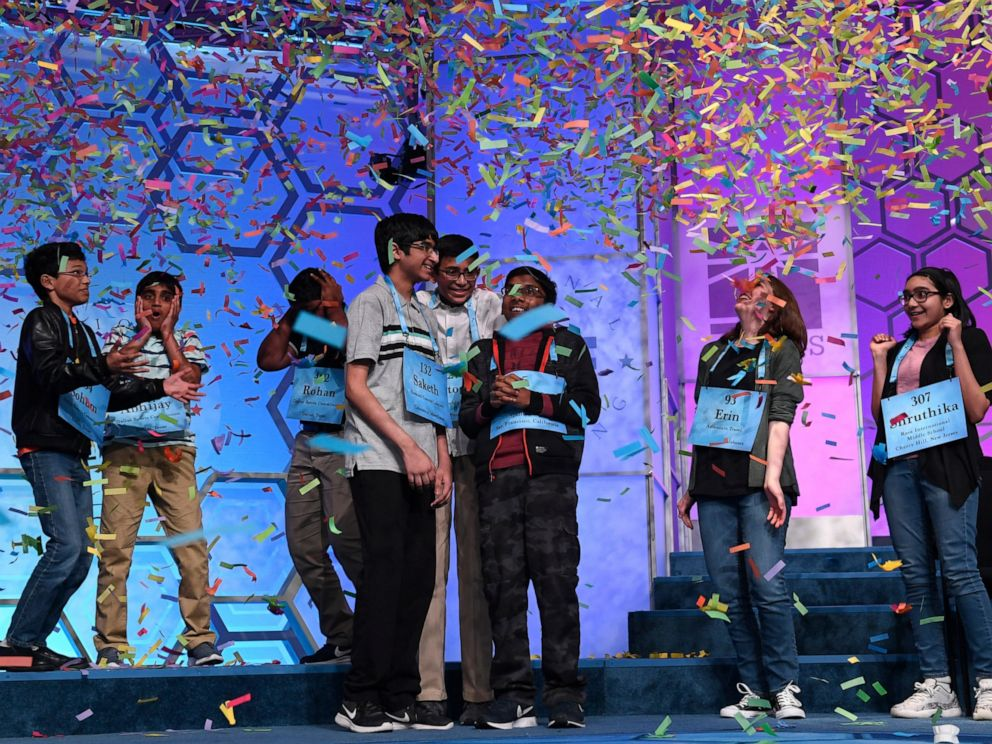 PHOTO: The eight co-champions of the 2019 Scripps National Spelling Bee, from left, Sohum Sukhatankar, Abhijay Kodali, Rohan Raja, Saketh Sundar, Christopher Serrao, Rishik Gandhasri, Erin Howard and Shruthika Padhy, celebrate their win.