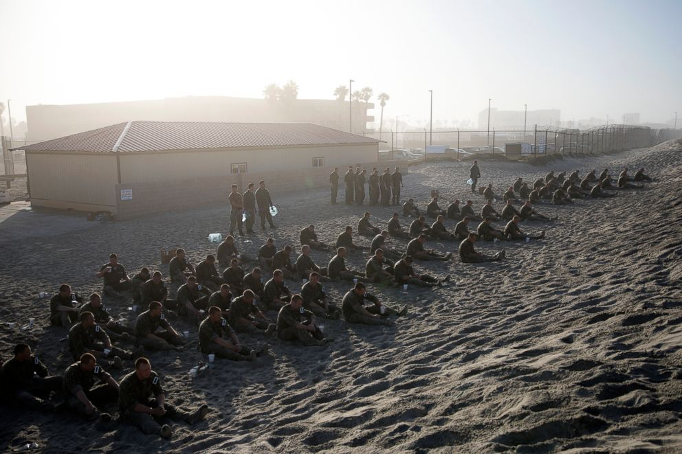 PHOTO: Navy SEAL candidates participate in Basic Underwater Demolition/SEAL (BUD/S) training.