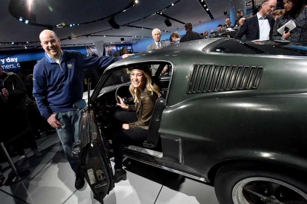 PHOTO: Sean Kiernan and Molly McQueen, the granddaughter of Steve McQueen, pose in Kiernans 1968 Mustang GT at the Detroit auto show, Jan. 14, 2018, in Detroit, Michigan.