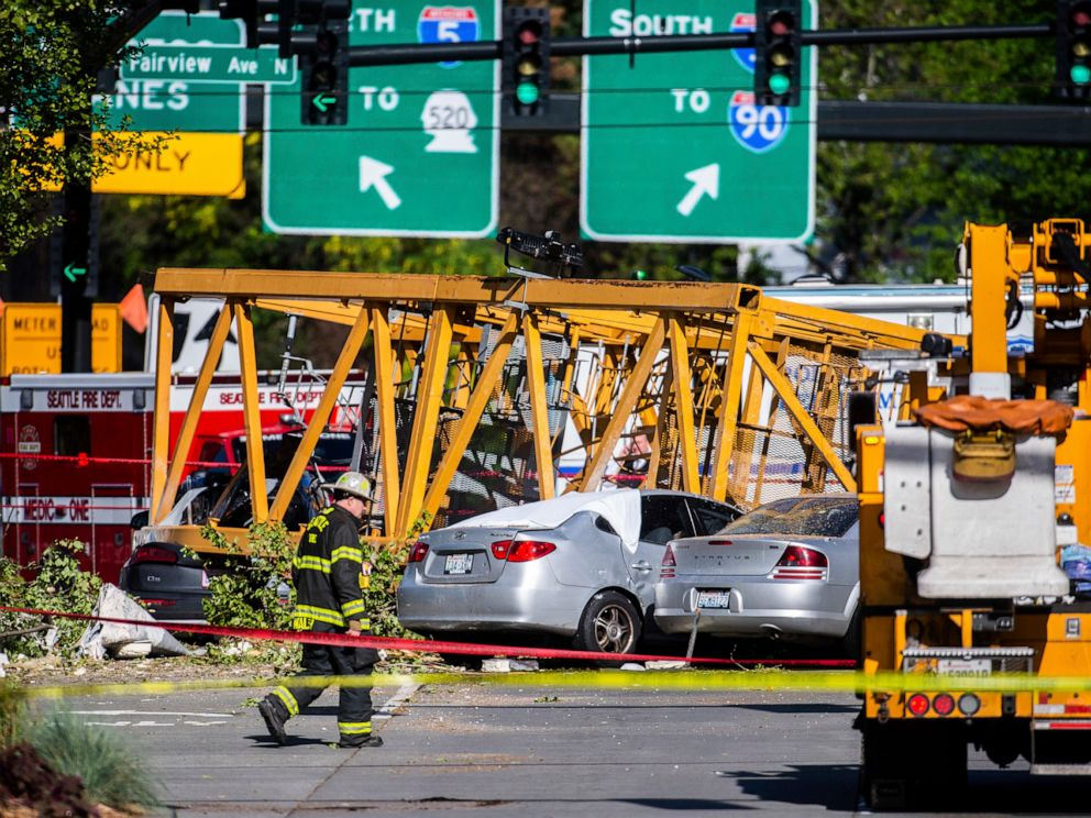 PHOTO: Emergency crews work the scene of a construction crane collapse near Interstate 5 in Seattle, on Saturday, April 27, 2019. The crane was atop an office building under construction in a densely populated area.