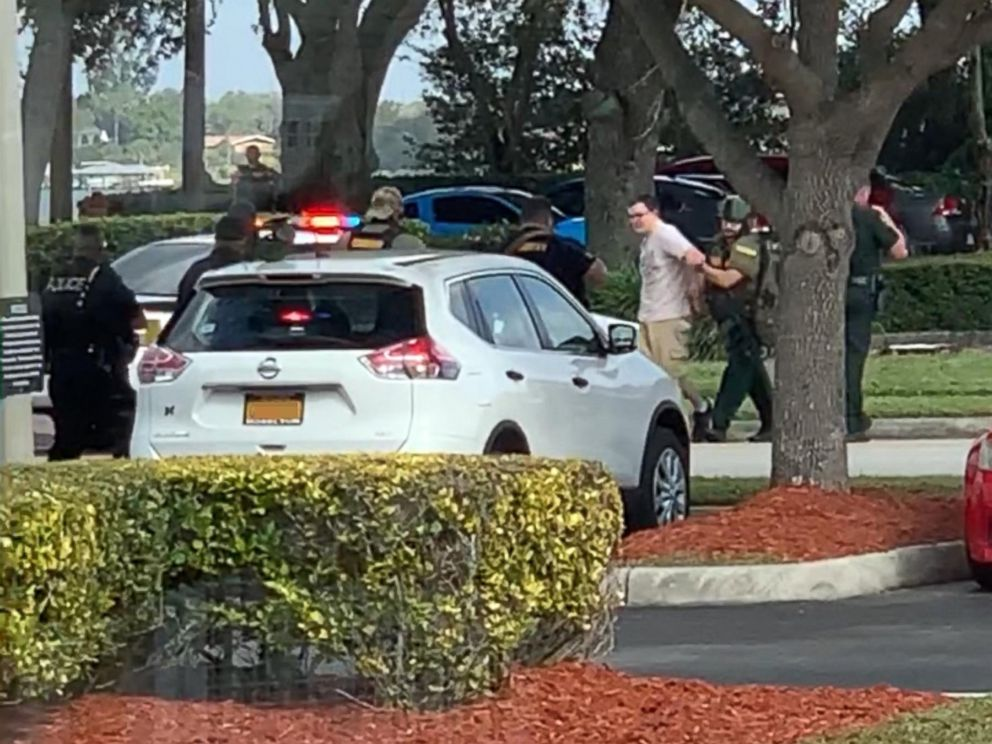 PHOTO: Video shared on social media shows a man being led out of a SunTrust branch in Sebring, Fla., after a shooting on Jan. 23, 2019.