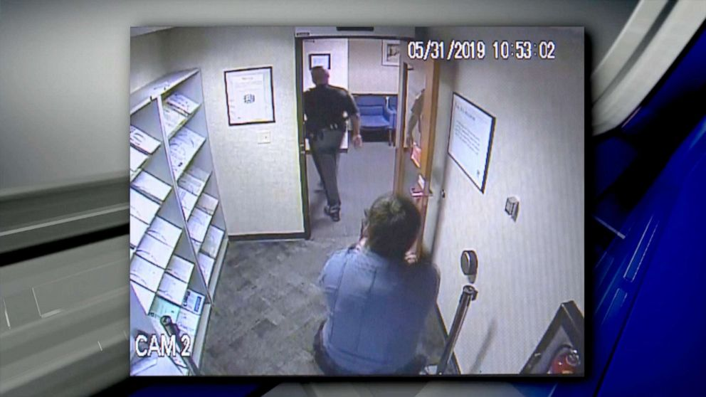 PHOTO: Security video shows security guard Seth Eklund pulling a gun on Lucas County, Ohio, Sheriffs Deputy Alan Gaston at an IRS office in Toledo on May 31, 2019.