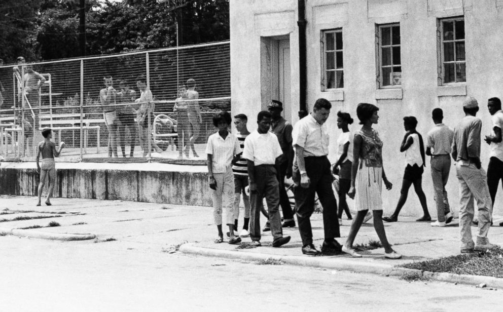 People march in protest of the all-white policy at a segregated swimming pool in Cairo, Ill., July 23, 1962.