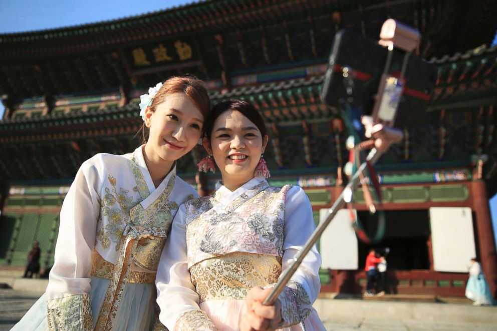 PHOTO: Visitors using a selfie stick to take pictures of themselves at Gyeongbokgung, a palace built by Joseon Dynasty in Seoul, Korea, Oct.25, 2017.