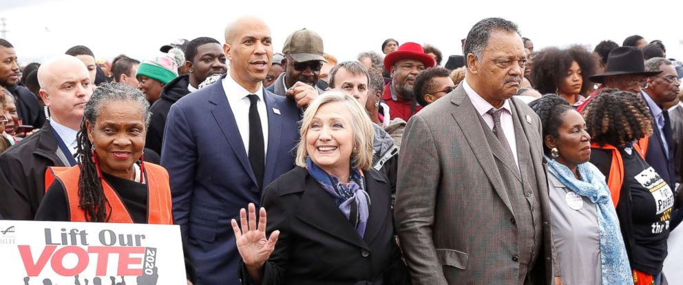 PHOTO: Democratic 2020 presidential candidate and Senator Cory Booker (D-NJ), Hillary Rodham Clinton, and Rev. Jesse Jackson march across the Edmund Pettus Bridge during the Bloody Sunday commemorative march in Selma, Ala., March 3, 2019.
