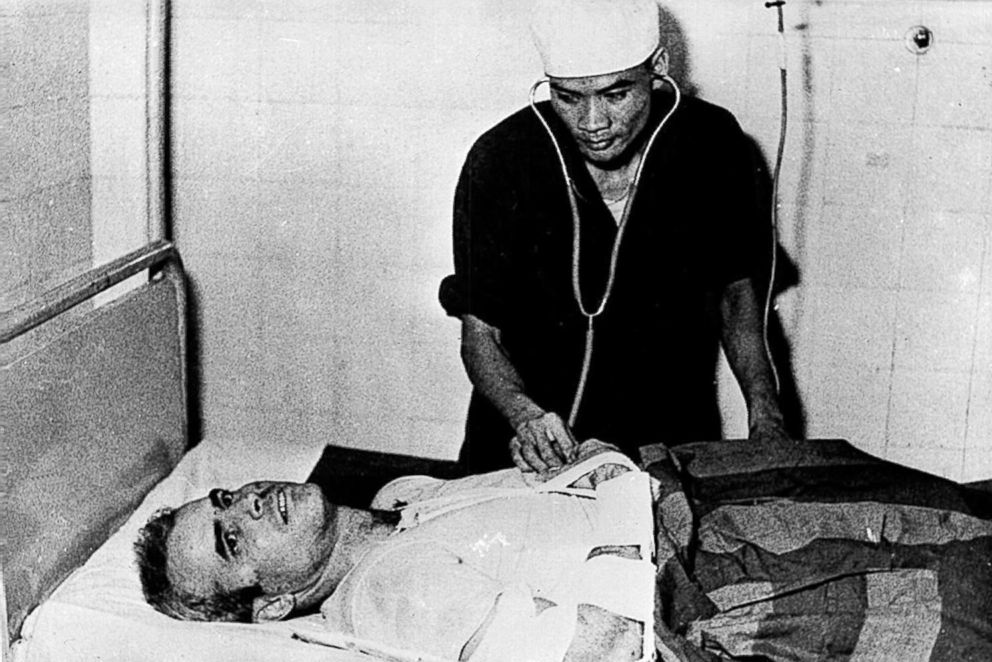 PHOTO: Major John McCain is examined by a Vietnamese doctor after being rescued when his warplane was shot down in Vietnam in 1967.
