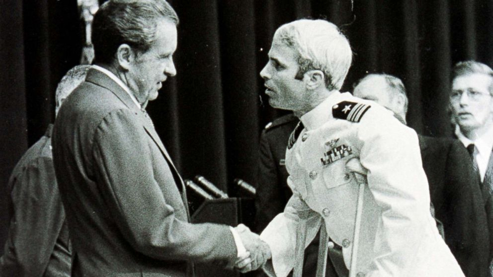 Lieutenant Commander John McCain is welcomed by President Richard Nixon upon his release as a POW during the Vietnam War, May 24, 1973, in Washington.