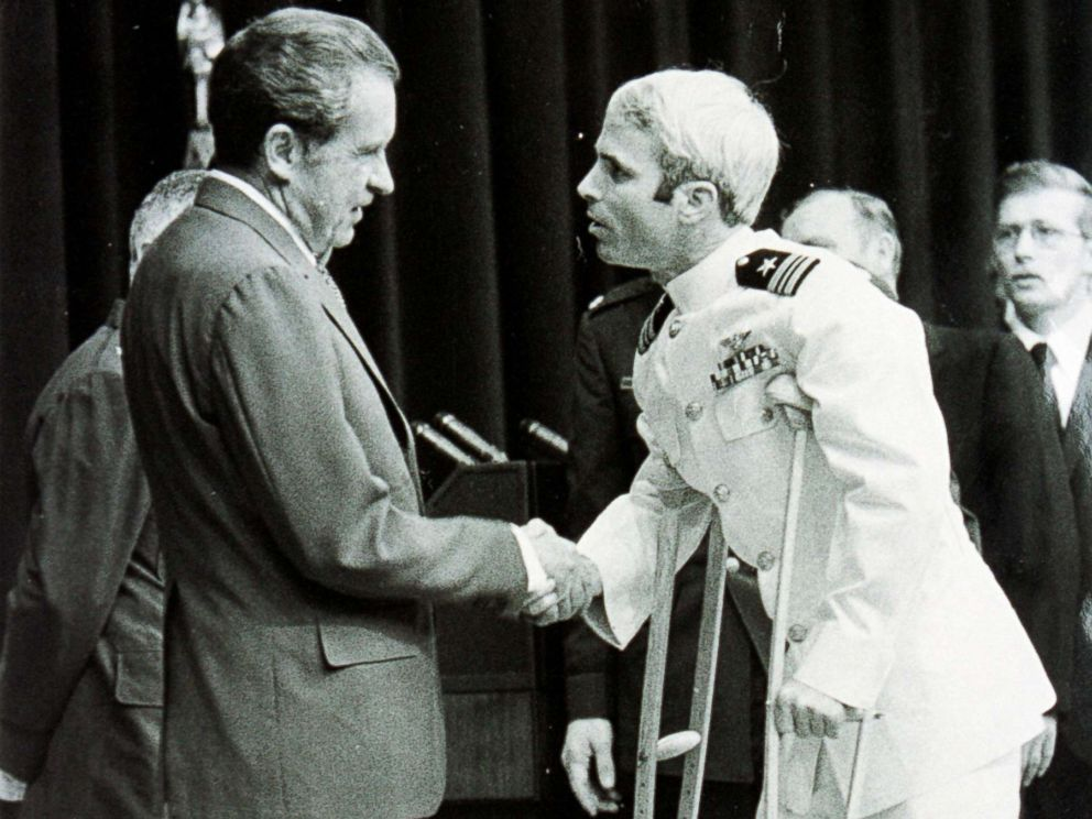 PHOTO: Lieutenant Commander John McCain is welcomed by President Richard Nixon upon his release as a POW during the Vietnam War, May 24, 1973, in Washington.