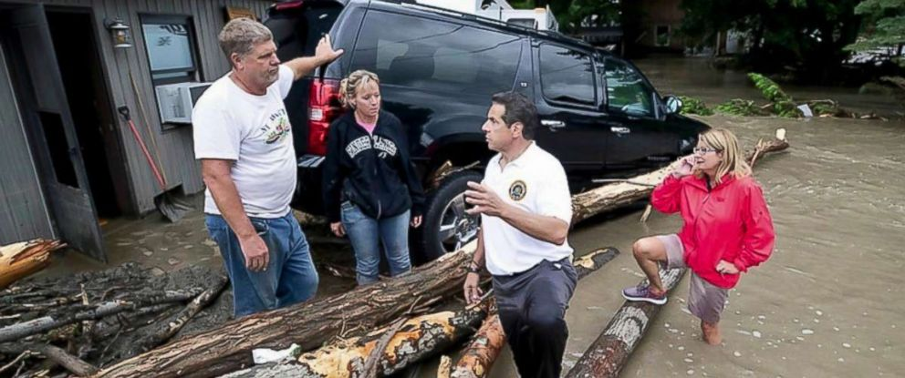 This photo provided by Governors Press Office shows New York Governor Andrew Cuomo, second from right, as he tours flooded upstate areas of Seneca and Broome counties, Tuesday, Aug. 14, 2018.