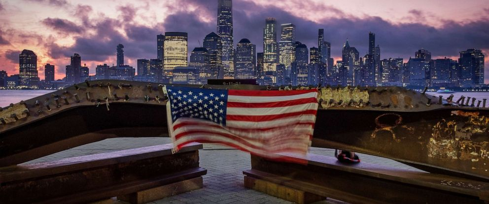 PHOTO: A U.S. flag hanging from a steel girder, damaged in the Sept. 11, 2001 attacks on the World Trade Center, blows in the breeze at a memorial in Jersey City, N.J., Sept. 11, 2019.