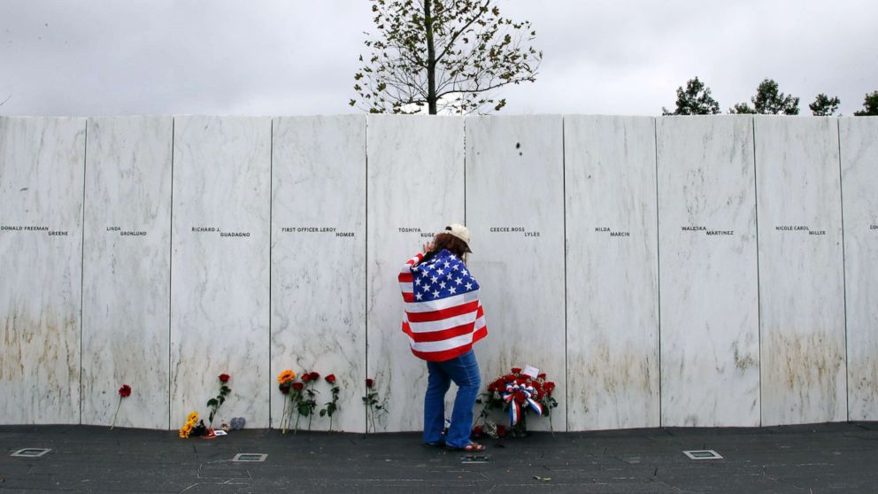 Chrissy Bortz of Latrobe, Pa., pays her respects at the Wall of Names at the Flight 93 National Memorial in Shanksville, Pa. after a Service of Remembrance, Sept. 11, 2018, as the nation marks the 17th anniversary of the Sept. 11, 2001 attacks.