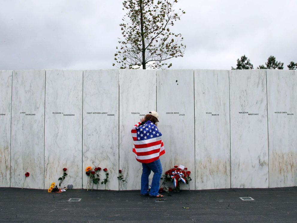PHOTO: Chrissy Bortz of Latrobe, Pa., pays her respects at the Wall of Names at the Flight 93 National Memorial in Shanksville, Pa. after a Service of Remembrance, Sept. 11, 2018, as the nation marks the 17th anniversary of the Sept. 11, 2001 attacks.