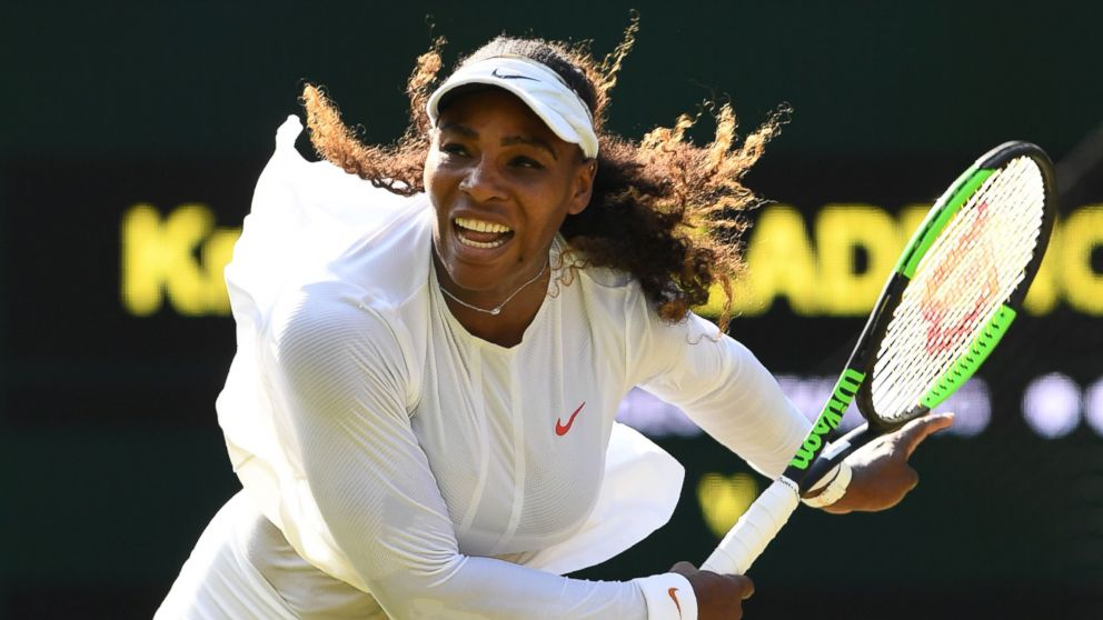 Serena Williams serves to France's Kristina Mladenovic in their women's singles third round match on the fifth day of the 2018 Wimbledon Championships, in southwest London, July 6, 2018.