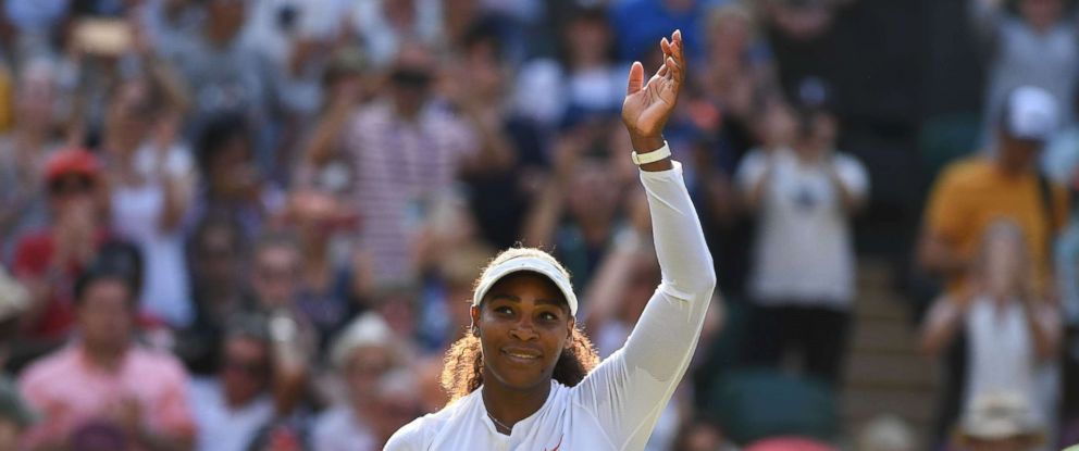 PHOTO: Serena Williams celebrates after beating Frances Kristina Mladenovic 7-5, 7-6 in their womens singles third round match on the fifth day of the 2018 Wimbledon Championships, southwest London, July 6, 2018.