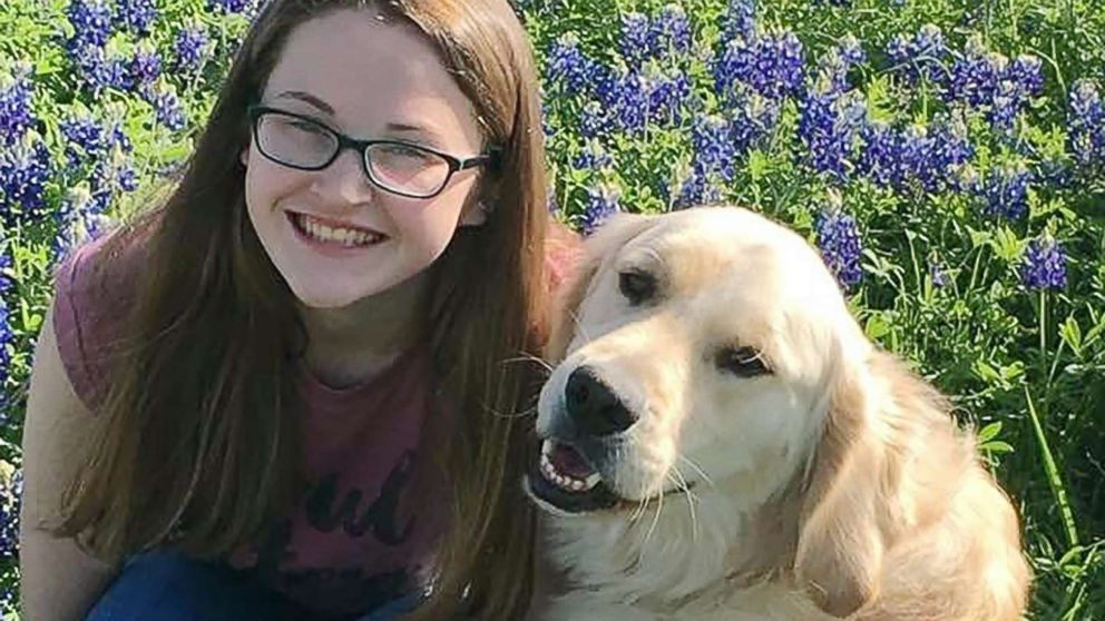 Hannah Westmoreland is pictured with her service dog Journey.