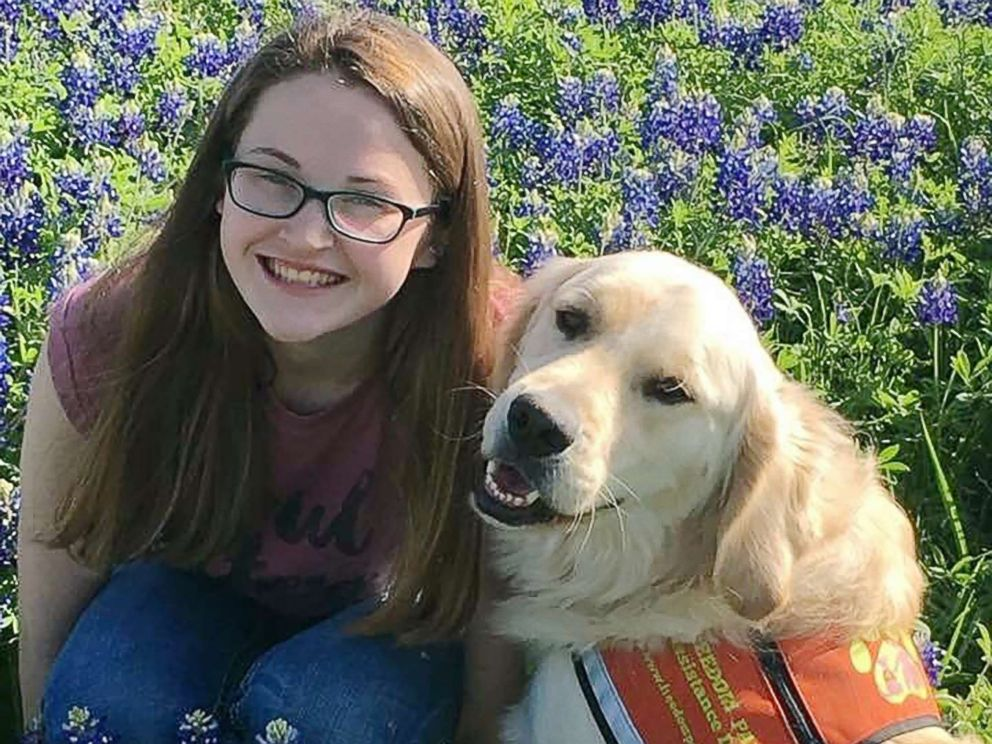 PHOTO: Hannah Westmoreland is pictured with her service dog Journey.