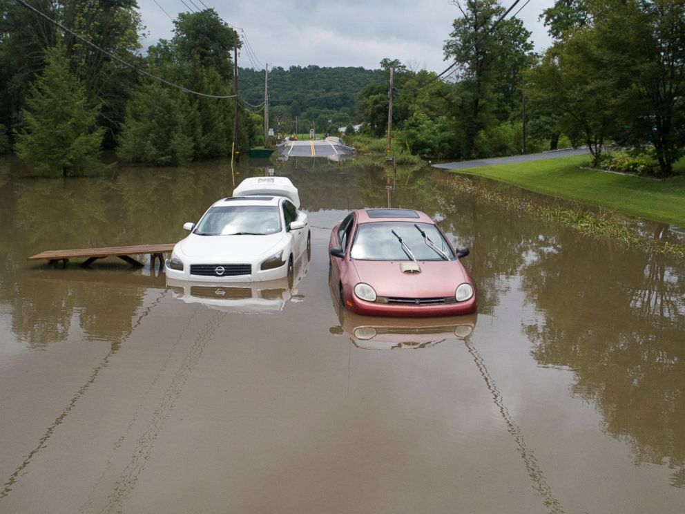 PHOTO: Abandoned vehicles and picnic tables sit along Route 645 in Pine Grove, Pa., after flood waters from a storm stalled them, July 23, 2018.