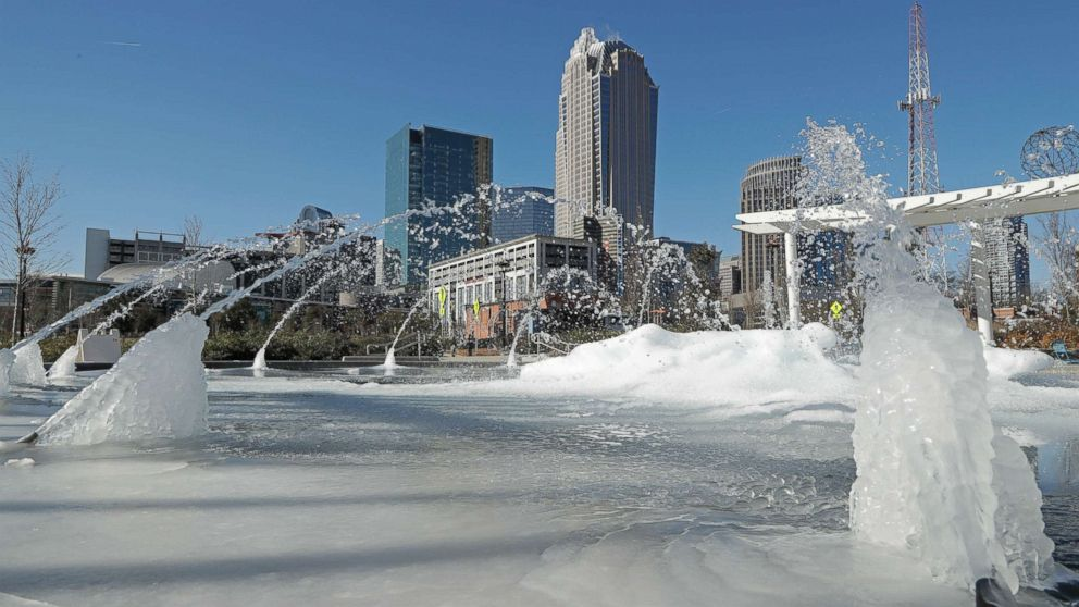 Water squirts from a frozen fountain near downtown in Charlotte, N.C., Jan. 2, 2018.