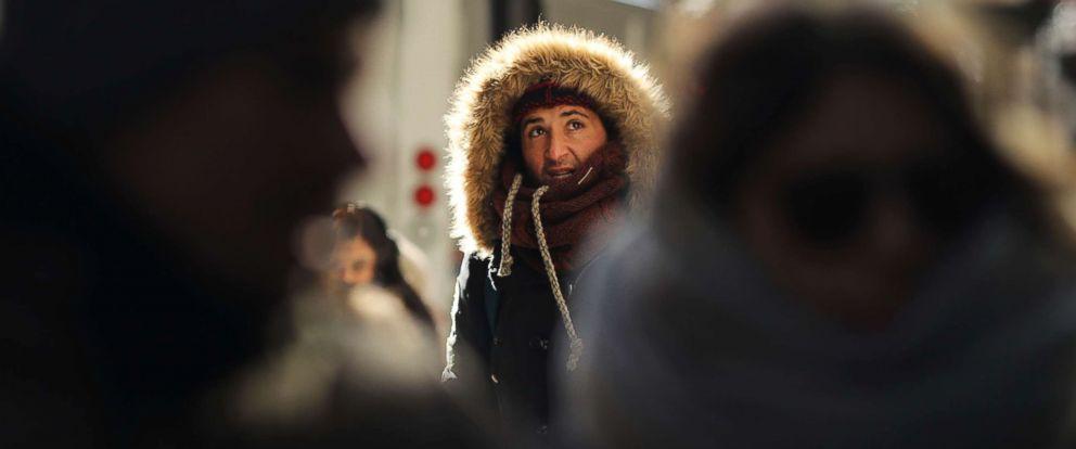 PHOTO: People walk through a frigid Manhattan, Dec. 28, 2017, in New York City.