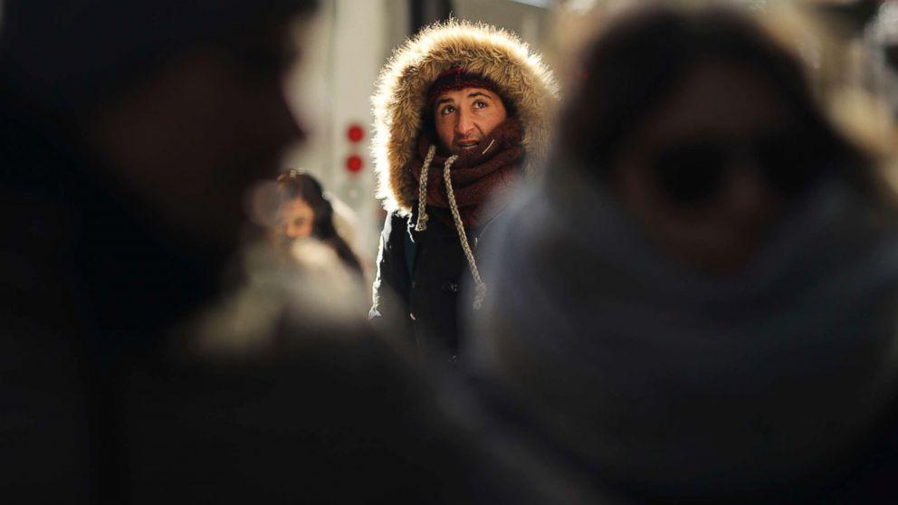 People walk through a frigid Manhattan, Dec. 28, 2017, in New York City.